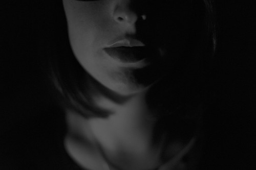 Mysterious woman, black overcast, serious, suspenseful