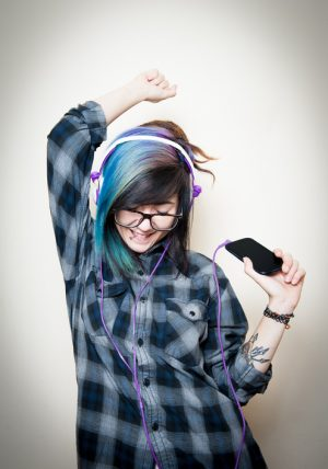person-with-bright-hair-listening-to-music-300x428