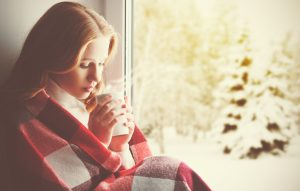 sad-wrapped-in-blanket-hot-drink-300x191